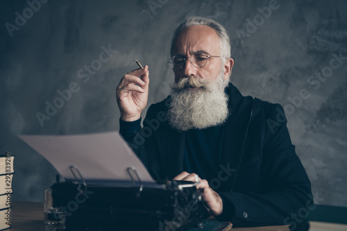 Close-up portrait of his he nice attractive focused concentrated bearded gray-ha Fototapet