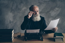 Portrait Of His He Nice Attractive Bearded Focused Concentrated Gray-haired Professional Expert Creative Publisher Reading News Life Story Article Essay Over Concrete Wall Background