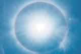 Fototapeta Tęcza - Sun halo phenomenon, circular rainbow around the sun.