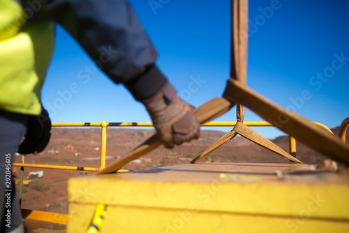 Fototapeta Blurry rigger hand holding a three tone lifting sling to control, stabilising th