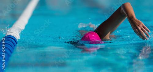 Swim competition swimmer athlete doing crawl stroke in swimming pool Wallpaper Mural
