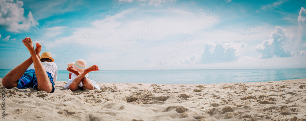 Fototapeta father with little daughter relax on beach