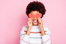 Photo Of Pretty Dark Curly Skin Lady Holding In Hands Little Red Paper Hearts Hiding Flirty Eyes Wear White Striped Pullover Isolated Pastel Pink Color Background