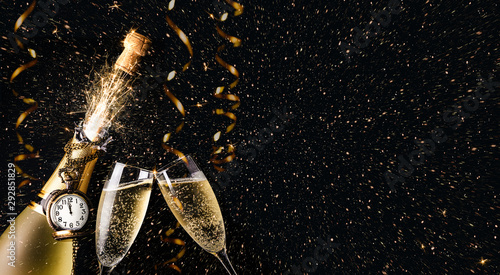 New year party concept with a exploding champagne bottle Wallpaper Mural