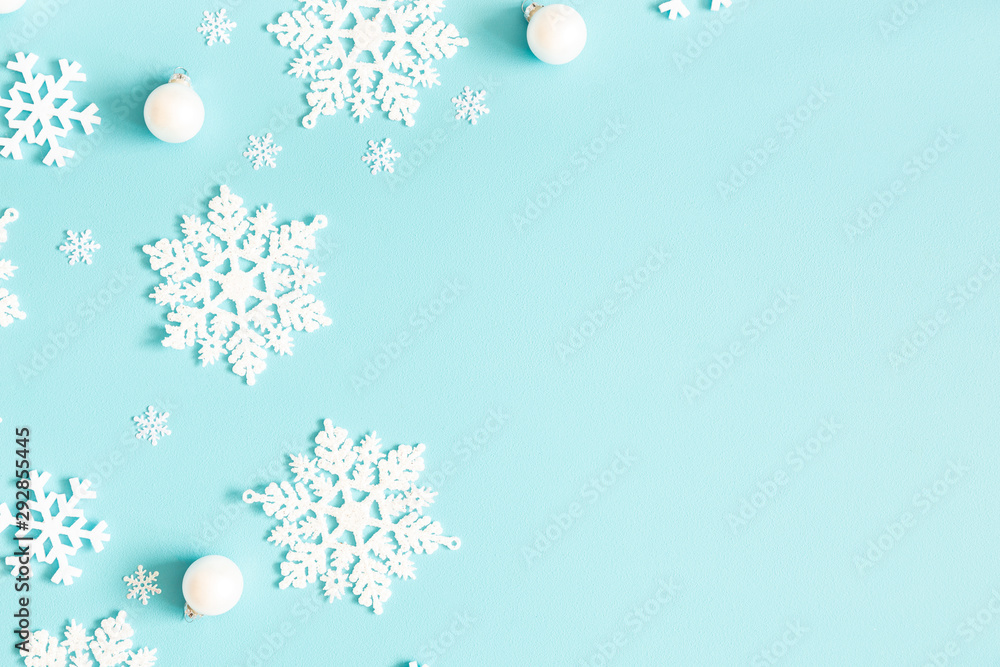 Fototapeta Christmas or winter composition. Pattern made of snowflakes on pastel blue background. Christmas, winter, new year concept. Flat lay, top view, copy space
