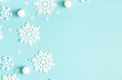 canvas print picture - Christmas or winter composition. Pattern made of snowflakes on pastel blue background. Christmas, winter, new year concept. Flat lay, top view, copy space