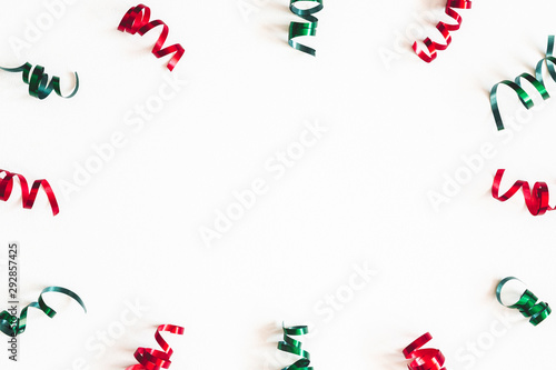 Obraz Christmas composition. Ribbon decorations on white background. Christmas, winter, new year concept. Flat lay, top view, copy space - fototapety do salonu