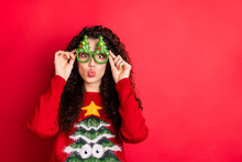 Photo Of Funny Curly Lady Sending Pouted Kisses Playful Mood Wear Funky Evergreen Trees Form Specs Knitted Pullover Isolated Red Color Background
