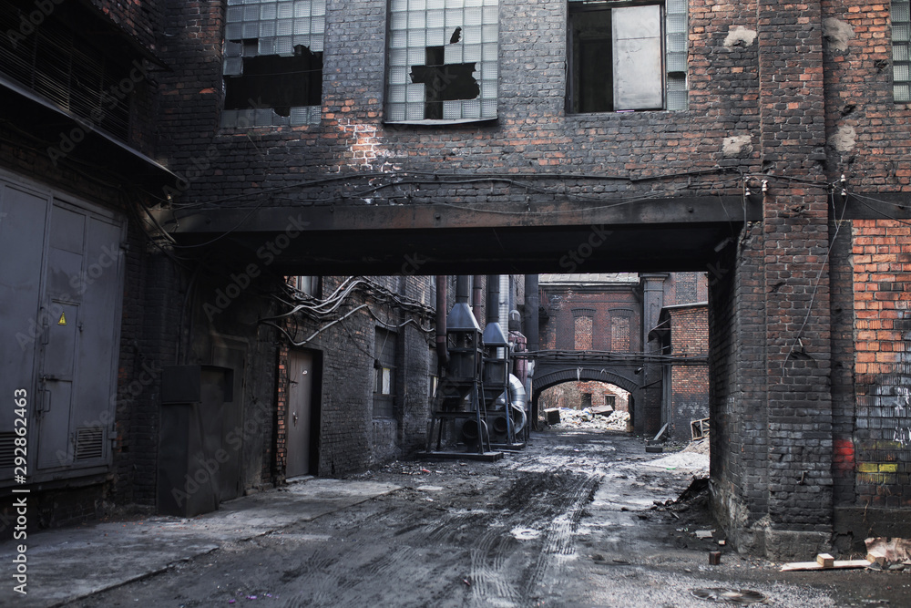 Fototapeta Old abandoned factory. Gothic background. Scary place. Post apocalyptic landscape. Halloween party place. Abandoned buiding. Industrial background