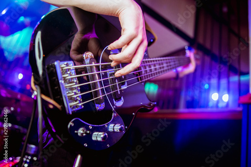 A man is playing guitar on stage, close-up. - 292862446