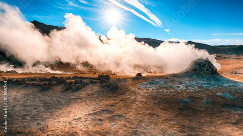 Steaming cone in Hverir geothermal area with boiling mudpools and steaming fumar Wallpaper Mural
