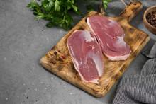 Raw Duck Meat On A Wooden Boar...