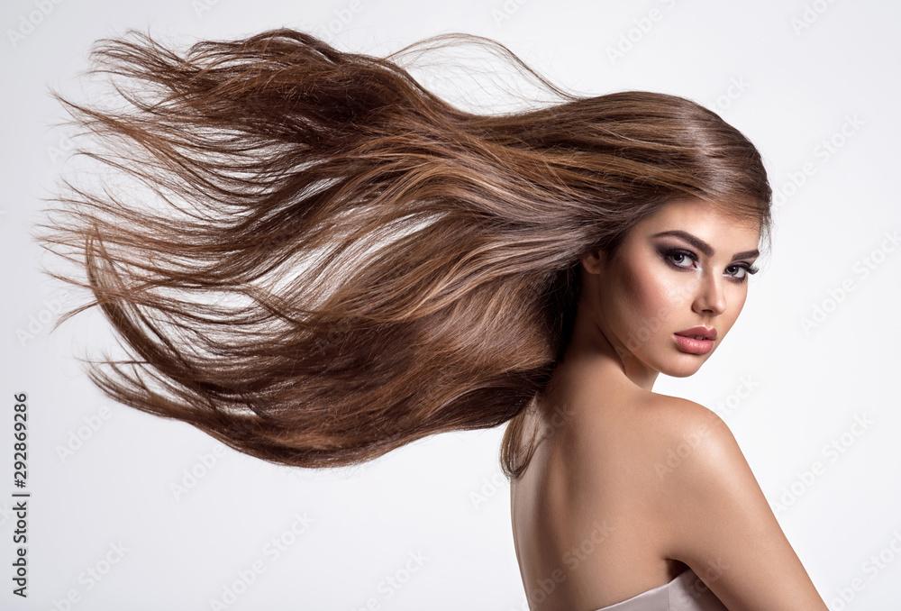 Fototapeta Portrait of a beautiful woman with a long hair.