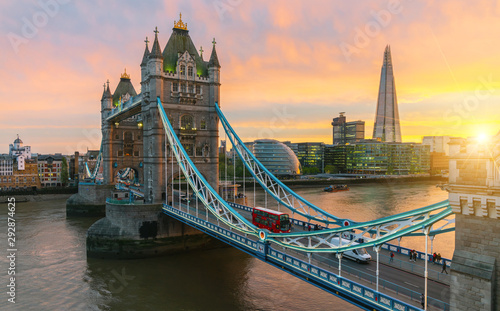 Poster London Aerial view to the illuminated Tower Bridge and skyline of London, UK, just after sunset