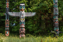 Totem Poles Located In A Clear...