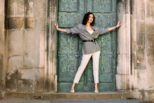 A Young Woman In White Pants A...