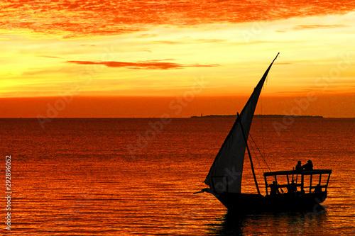 Montage in der Fensternische Sansibar Dhow boat in Zanzibar at sunset