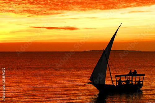 Foto auf Gartenposter Sansibar Dhow boat in Zanzibar at sunset