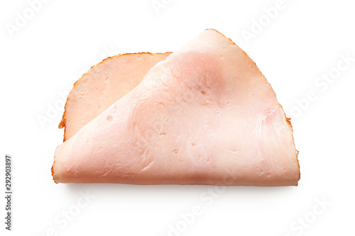 A folded single slice of chicken ham isolated on white. Top view. - 292903897