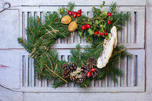 Autumn Wreath From Pine Needles, Pine Cones, Rosehips Nuts And Tree Mushrooms. Coming Fall DIY. Ornament On A Wooden Window.