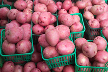 A Pile Of Red Skinned Potatoes...