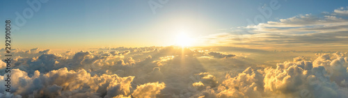 Obraz Panorama sunrise from the top of the mount Fuji. The sun is shining strong from the horizon over all the clouds and under the blue sky. good New year new life new beginning. Abstract nature background - fototapety do salonu
