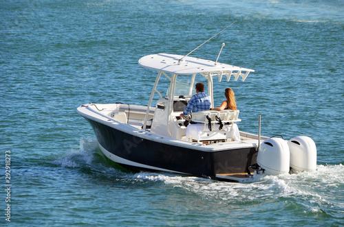 Fotografia, Obraz Man and a woman enjoying a slow cruise on the Florida Intra-Coastal Waterway off