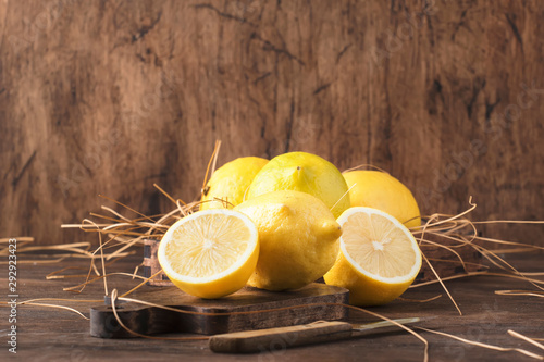 Juicy lemons on rustic kitchen table, copy space, selective focus Poster Mural XXL