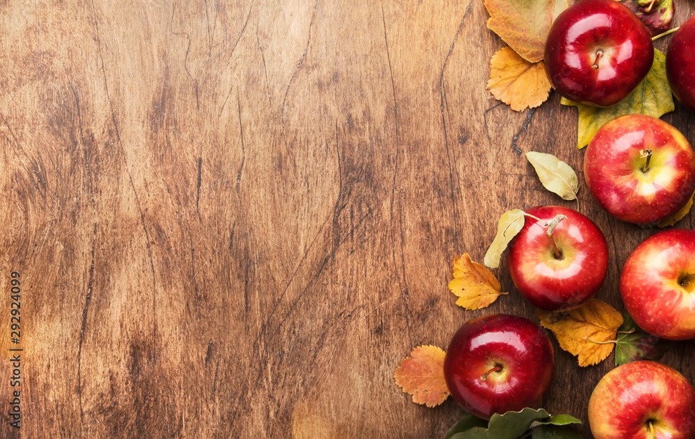 Fototapety, obrazy: Autumn food background. Ripe apples with nuts, fallen leaves and cinnamon on rustic wooden table. Top view. Copy space