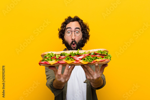 Printed kitchen splashbacks Snack young crazy bearded man with a giant sandwich.