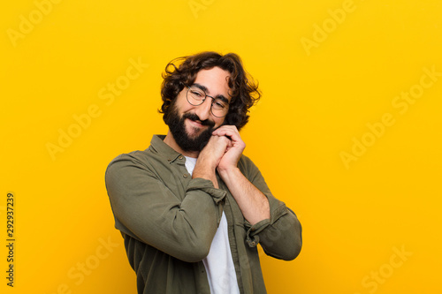 Fotografie, Obraz  young crazy man feeling in love and looking cute, adorable and happy, smiling ro