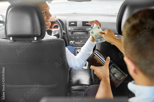 Fotomural transportation, taxi and payment concept - male car driver taking money from pas