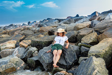 Lady Relaxing On Boulders By T...
