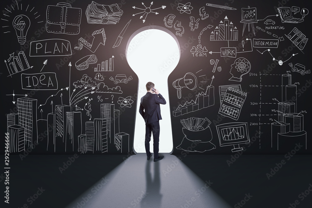 Fototapety, obrazy: Rear view of a businessman against black wall with a keyhole path