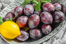 Fresh Organic Plums And Lemon On A Metal Vintage Dish. Still Life Of Ripe And Juicy Fruits In The Sunlight. Closeup