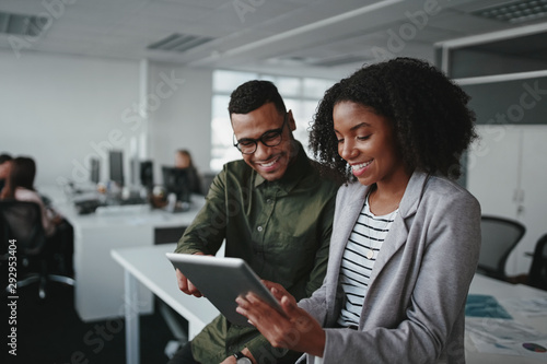 Fotografía Smiling young african american professional businessman and businesswoman togeth