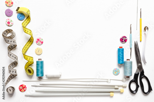 Sewing flat lay composition with threads, fabrics, scissors, buttons and sewing accessories on a white background, flat lay Canvas Print