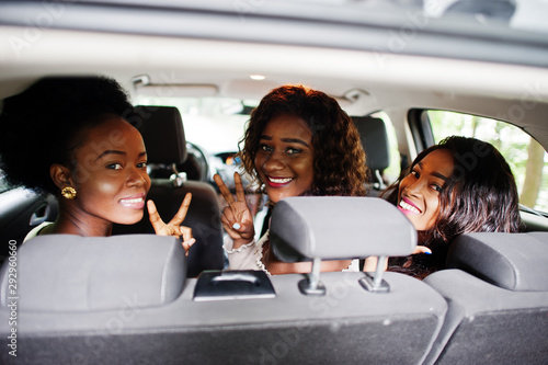 fototapeta na ścianę Group of african american girls friends having fun in the car.
