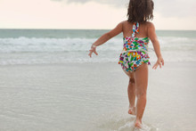 A Little Girl At The Beach Pla...