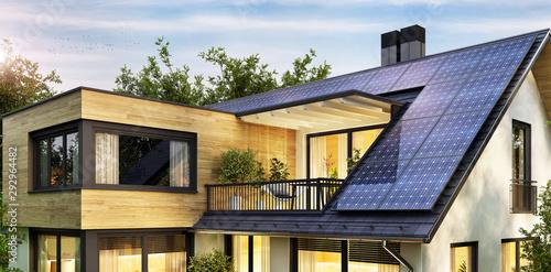 Obraz Solar panels on the gable roof of a modern house - fototapety do salonu