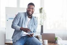 Cheerful Black Employee Using ...