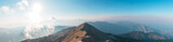 Fototapeta  - Panoramic view of Taurus Mountain at sunset from the top of Tahtali Mountain near Kemer, Antalya, Turkey