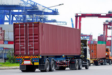Container Truck In Ship Port Logistics.Transportation Industry In Port Business Concept.import,export Logistic Industrial Transporting Land Transport On Port Transportation Storge