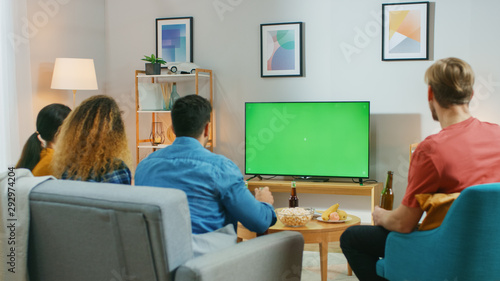 Happy Friends Sitting At Home Watching Green Chroma Key Screen, Relaxing on a Couch Canvas Print