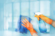 canvas print picture - The cleaning lady washes the blue surface .