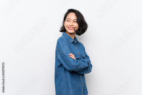 Asian young woman over isolated white background with arms crossed and happy Tapéta, Fotótapéta