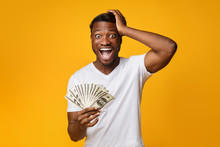 Excited Afro Guy Holding Money...