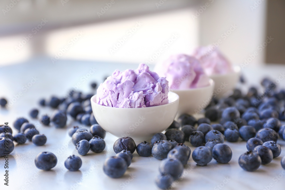 Fototapety, obrazy: Bowls with tasty blueberry ice cream on light table