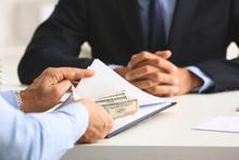 Businessman Taking Bribe At Workplace