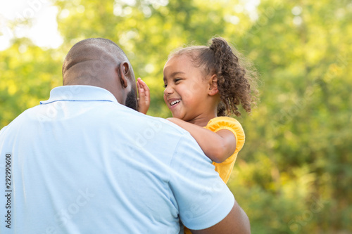 Father laughing and playing with his daugher. Canvas Print